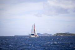 Catamaran sailing. Through the water in the tropics Royalty Free Stock Image