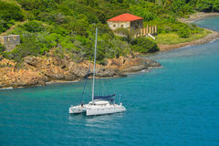 Free Catamaran Sailing By Garrison House At Fort Willoughby On Hassel Island, St Thomas U.S. Virgin Islands. Royalty Free Stock Photography - 95221967