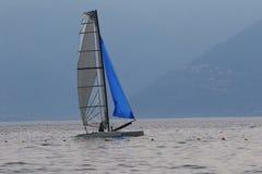 Catamaran sailing on a lake Stock Photos