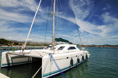 Catamaran - a sailing vessel. Royalty Free Stock Photo