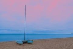 Catamaran on a  sandy beach Stock Image