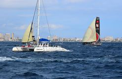 A Catamaran And Scallywag Volvo Ocean Race Alicante 2017. The racing yacht getting close to a spectator boat in Alicante bay on the first leg of the round the Royalty Free Stock Photos