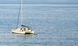 Boat, Garitsa Bay, Corfu, Greece. Sailboat in Garitsa Bay, Corfu, Greece Royalty Free Stock Images