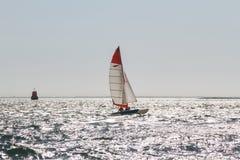 A catamaran on a silver sea Stock Photo