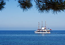 Catamaran taking tourists on a boat trip Royalty Free Stock Image