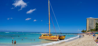 Catamaran waiting for tourists at Waikiki Beach Stock Photos