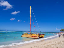 Catamaran waiting for tourists at Waikiki Beach Stock Photo