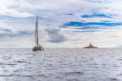 Catamaran and watchtower Royalty Free Stock Image