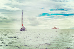 Catamaran and watchtower Stock Photos