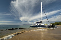 Catamaran, West Maui Mountains in background. Hawaii Stock Photos