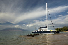 Catamaran, West Maui Mountains in background. Hawaii Stock Images