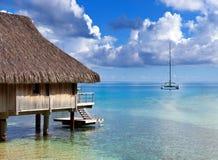 Catamaran and wooden hut at the sea. Stock Photos