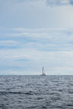 Catamaran yacht in distance Stock Photo