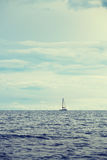 Catamaran yacht in distance Stock Image