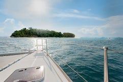 Catamaran yacht sailing towards the island ahead in Phuket, Thailand Stock Photo