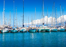 Catamaran yachts and boats in the harbor. Stock Photography