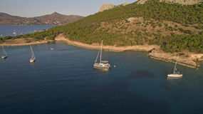 Catamaran and yachts in the sea near Greek island Stock Images