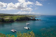 Catamarans anchored at a pristine bay in Maui, Hawaii stock photos