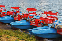 Catamarans. Catamarans on the bank of the lake Stock Photography
