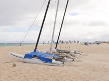 Catamarans on the beach of Fuerteventura. Catamarans on the beach of Parque Natural de las Dunas de Corralejo. This park is a nature area with sand dunes in the Stock Images