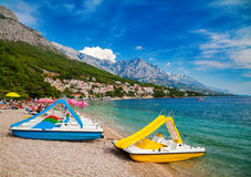 Catamarans on a beautiful beach in Brela. Makarska Riviera, Croatia Royalty Free Stock Photography