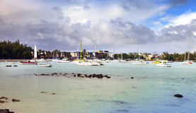 Catamarans and boats in a bay. Grand Bay (Grand Baie). Mauritius Royalty Free Stock Photos