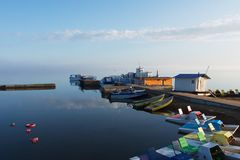 Catamarans and boats in the foggy morning on the lake royalty free stock images