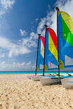 Catamarans on the Caribbean beach. Colorful sail catamarans on the Caribbean beach Royalty Free Stock Photo
