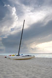 Catamarans on a Cuban Beach at Sunset. Vertical Image of Catamarans on a Cuban Beach at Sunset Stock Images