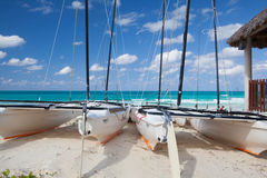 Catamarans on the empty beach, Cuba. Cayo Santa Maria, Cuba - January 31,2017:  Catamarans on the empty tropical beach, Cuba. Cayo Santa María is well known for Stock Photo