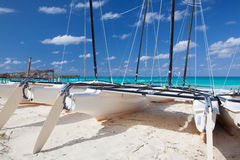 Catamarans on the empty beach, Cuba. Catamarans on the empty tropical beach, Cuba Royalty Free Stock Photos