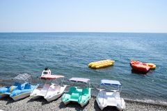 Catamarans and inflatable boats on the beach, on the dock. Novorossiysky beach wide beam. stock images