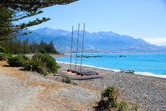 Catamarans on Kaikoura pebble Beach, New Zealand. Catamarans on Kaikoura pebble Beach, South island, New Zealand Stock Image