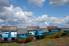 Catamarans on the lake bank Royalty Free Stock Photos