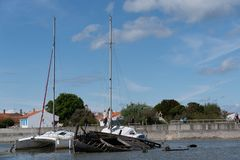 Boat cemetery near the city center of noirmoutier royalty free stock photography