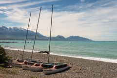 Catamarans on pebbly beach in Kaikoura. New Zealand Royalty Free Stock Images