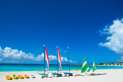 Catamarans on tropical beach. Catamarans on a beautiful Caribbean beach Stock Photo