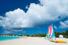 Catamarans at tropical beach. Catamarans at beautiful Caribbean beach Stock Photo