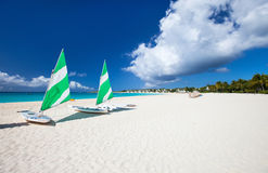 Catamarans at tropical beach. Catamarans at beautiful Caribbean beach Stock Photos