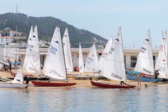 Catamarans with white sails parked on the beach against the backdrop of the blue sky, mountains. Outdoor sea sporting activity. Sea landscape Stock Photography