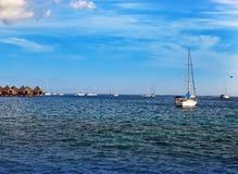 Catamarans and wooden huts at the sea. Royalty Free Stock Photos