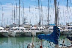Catamarans and yachts moored Stock Photos