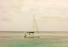 A catamran motoring in the bequia channel. A yacht arriving at its destination in the windward islands Stock Photos