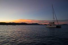 Catamran at Sunset. A catamaran at anchor at sunset, Whitsunday Islands, Australia Royalty Free Stock Image