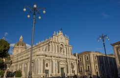 Catania baroque symbol, historical cathedral square, marble decorations in blue sky. Catania baroque cathedral square, historical basilica and cupola in blue sky stock image