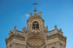 Catania detail of baroque architecture in basilica Collegiata, top of facade decorations. Catania baroque detail in Collegiata basilica, facade decorations in stock images