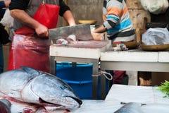 Catania fishmarket. Tuna fish on the table of a fish seller in the fishmarket of Catania, Sicily stock photo