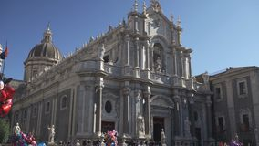 Catania, Italy - Sicily, Main square and Main Cathedral of Saint Agate, people and tourist walkin, blue sky stock video footage