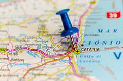 Catania on map. Macro shot of Catania on map with push pin. Catania is an ancient port city on Sicily`s east coast royalty free stock photos