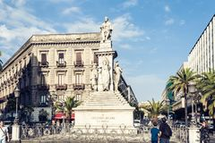 Catania, Sicily, Italy – august 08, 2018: people near famous landmark, monument Vincenzo Bellini on historical street of the royalty free stock photos